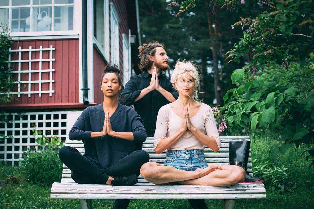women and man in a yoga pose